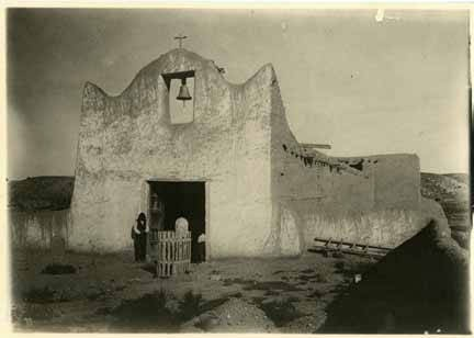 Coronado's expeditionary force first visited Santa Clara Pueblo in 1540. Catholic priests established a mission there in 1628; it was destroyed in the 1680 Pueblo Revolt. This adobe church, photographed by Adam Clark Vroman around 1899, was the second of two built afterward. It was replaced by the pueblo's current church in 1918. Courtesy Palace of the Governors Photo Archives, 12440.