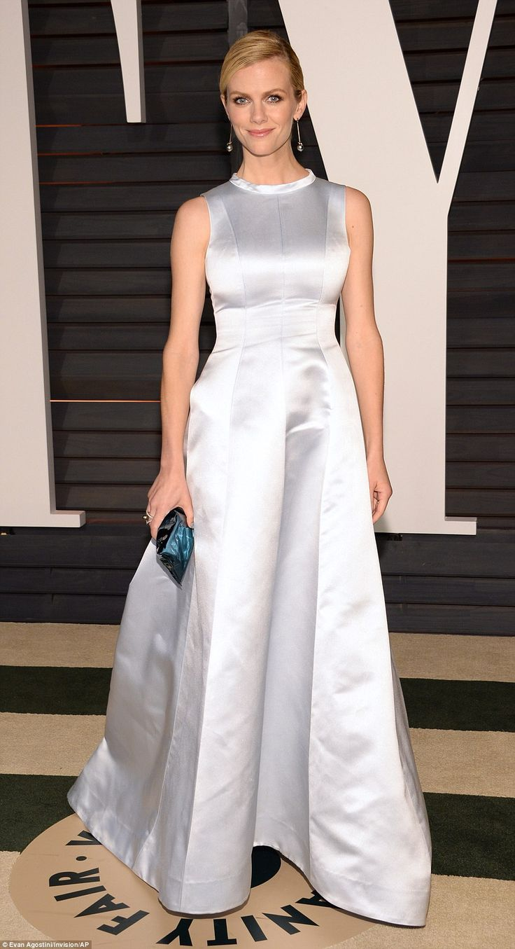 Model Brooklyn Decker concealed her charms in a white satin dress that looked more Victorian than Oscar night