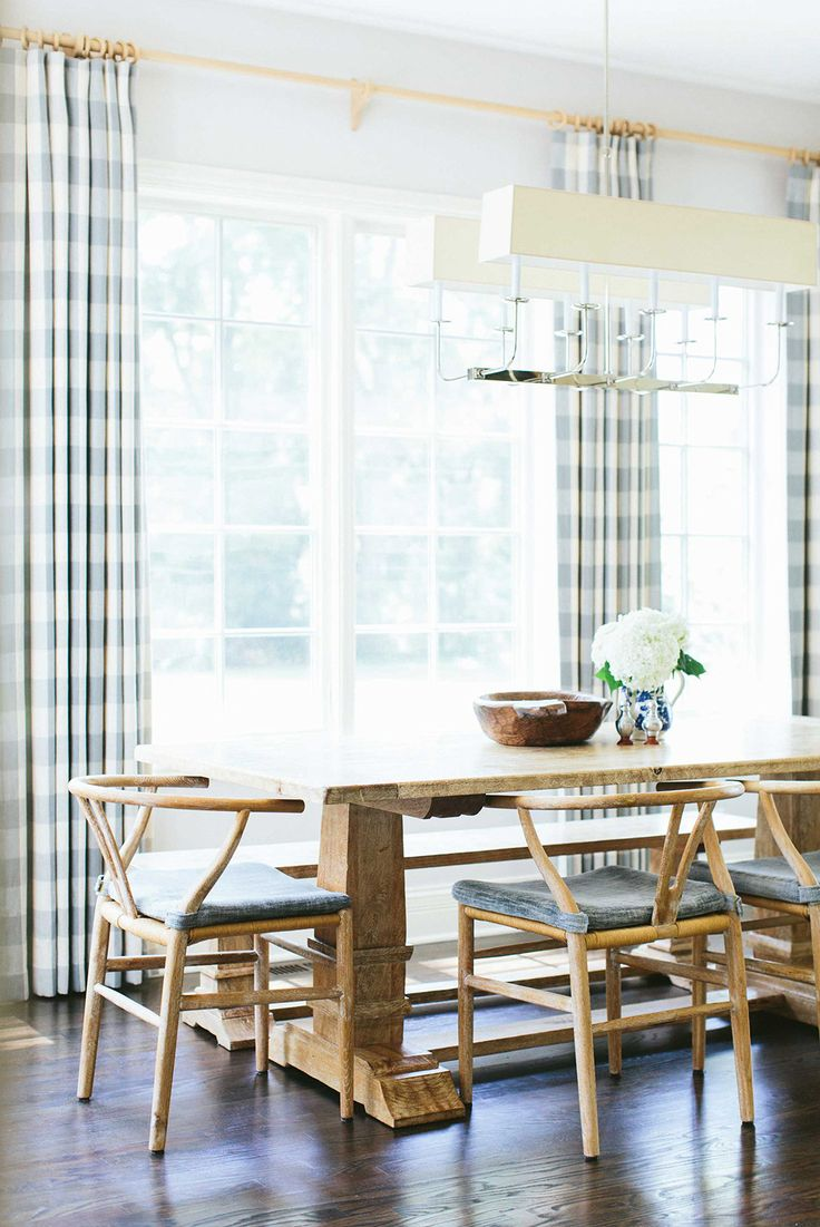 Natural light in the dining room with plaid curtains