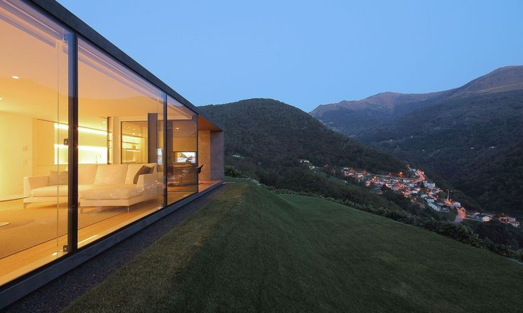 Set on a hill overlooking the Swiss Alps, Montebar Villa is a sustainable space designed by JM Architecture and takes advantage