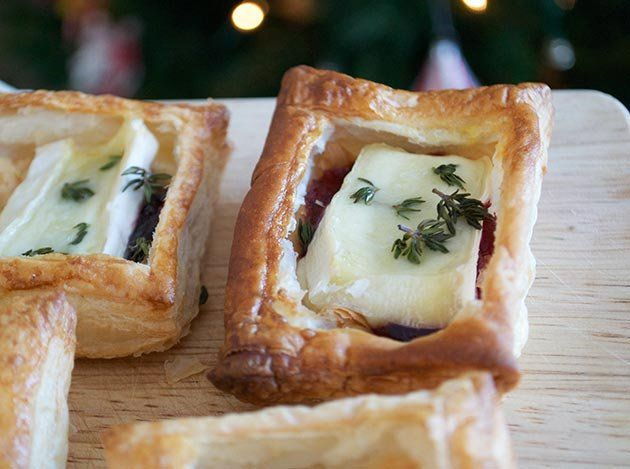 Christmas party foods with a twist  Got guests coming round for Christmas? Don't just reach for the sausage rolls in the freezer. Try making these simple party foods instead.  Christmas party food: Mini brie and cranberry tarts © Jo Romero