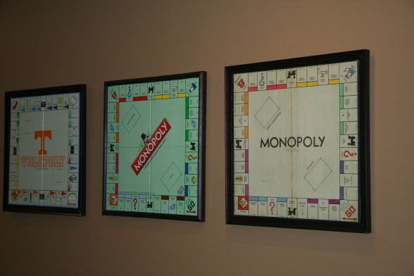 wanted to make game boards that you could take off the wall and actually use. To do this collect various games, we used monopoly which are 20x20 inches. Paint a canvas black, glue board to canvas and install a do it yourself fame, I go them from Michaels to fit the 20 inch canvas.