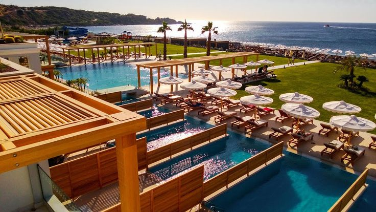 5★ Mitsis Alila Resort & Spa, #Rhodes Book this fantastic hotel NOW for 2015 from only £49pp deposit! Located directly on the beachfront ✔ Voted 4.5/5 on TripAdvisor ✔ Outdoor & indoor swimming pools and waterslides ✔ Enticing eateries including a beach bar with pizza oven & a Crêperie ✔ Wonderful relaxing spa & gym facilities ✔ Watersports, games room, shopping arcade ✔ Kids' club, playground & mini-disco ✔