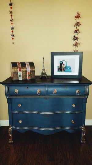 """Reconditioned/Certified - This is simply beautiful. I Completely refurbished this dresser with chalk paint and dark wax for a distresses finish. The dresser has been refinished in Annie Sloan """"Napoleonic Blue"""" chalk paint.   I sanded and stained the top and added poly coat for a rich lasting finish. I added new knobs and pulls.   Dimensions 32"""" tall, 16"""" wide, 42"""" long. The top wood piece measures 19'"""" wide.  This is a great piece and would be an excellent addition to any room needing a pop…"""