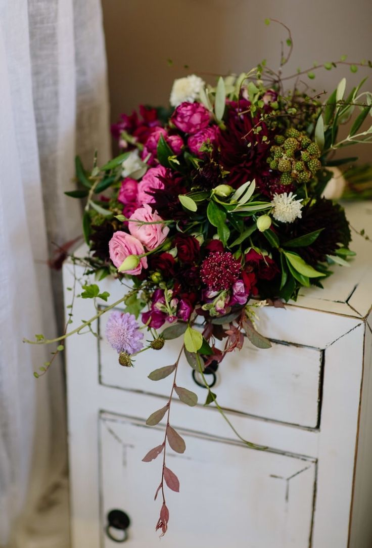 Stunning wild wedding bouquet. Such beautiful rich colours in a wild and free form. Created by the team at Florist ilene
