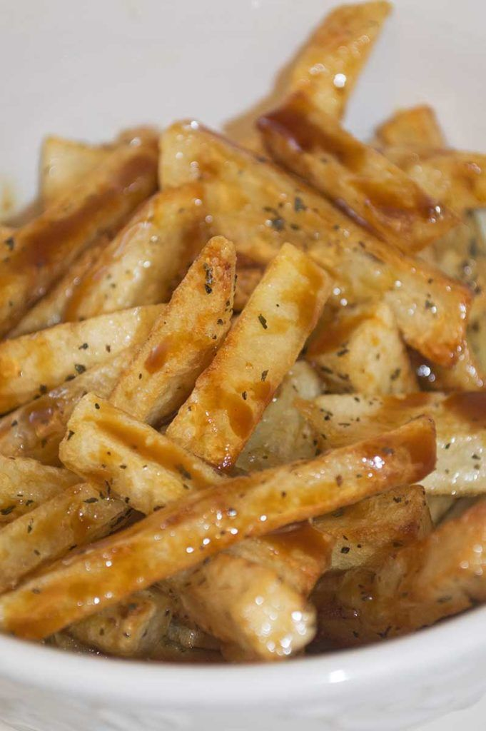 """Crispy golden french fries covered in maple """"butter"""" and drizzled with molasses """"mayo"""". These maple fries are sure to make your taste buds dance!"""