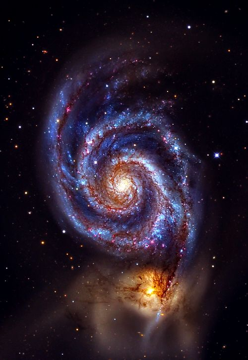 The Whirlpool Galaxy (M51A or NGC 5194) and (M51B or NGC 5195, left). The Whirlpool Galaxy is a grand-design spiral galaxy, interacting with NGC 5195, a dwarf galaxy. Both galaxies are located 23 ± 4 million light-years away in Canes Venatici.