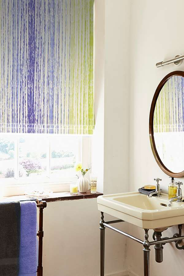 Our Azeta Azure Roman blind features blurred vertical stripes in blue and acid greeny yellow shades and is a contemporary update to more traditional striped designs. The colours conjure up images of the sea making this a lovely alternative for a coastal scheme, perfect for bathrooms.
