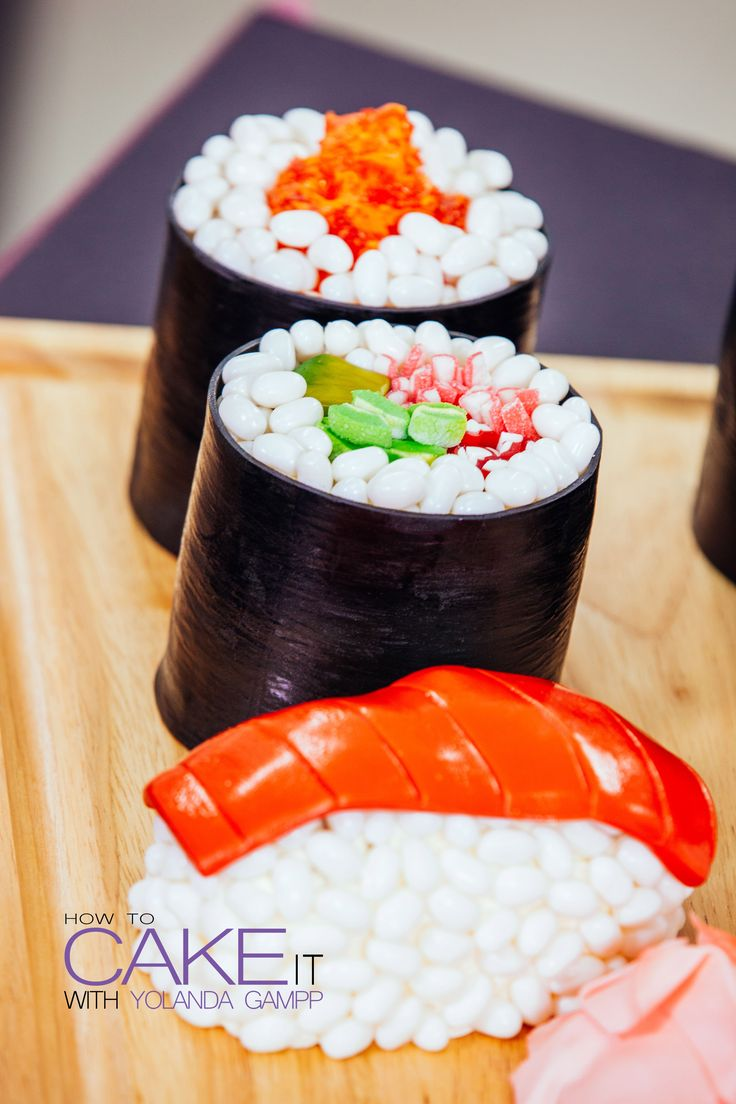 Making sushi with raw candy instead of raw fish! I made these sushi cakes out of chocolate sponge jelly rolls, vanilla cakes, and lots of fresh candy fishy toppings. #Baking #Dessert