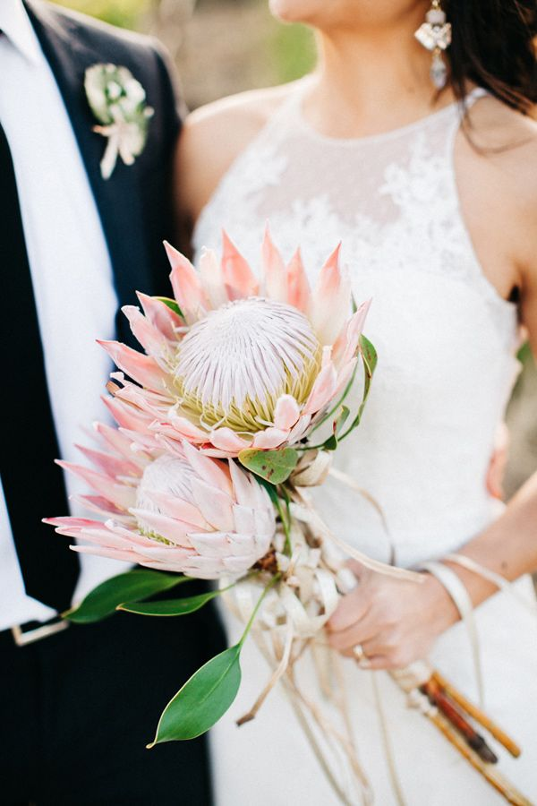 protea bouquet - photo by Catie Coyle Photography http://ruffledblog.com/gold-and-pink-vineyard-wedding