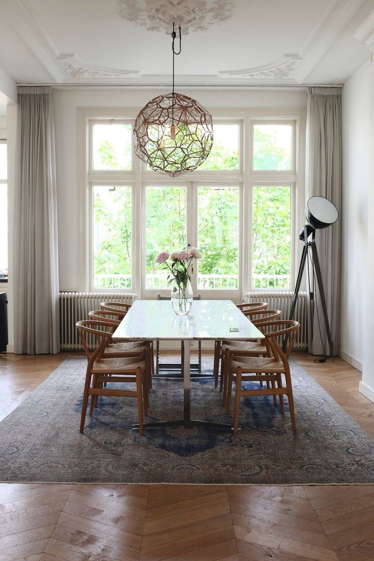 contemporary marries vintage architecture in this stunningly simple dining room. Sri's Classic & Contemporary Amsterdam Home