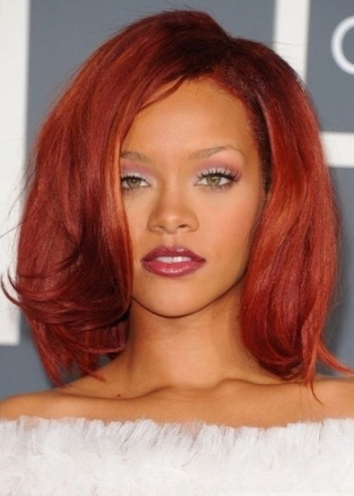 79. Rihanna African American Hairstyle: Fiery red long bob  We love Rihanna's red hair even more than her blonde locks! She wears her fiery red hair in a long, layered bob that barely grazes her collarbones. She's chosen the perfect length for her bob, as the long layers gently frame her face and soften the angles of her jaw.