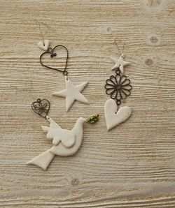 Ceramic and metal hanging ornaments/decorations...love all of these... feel an order coming on!