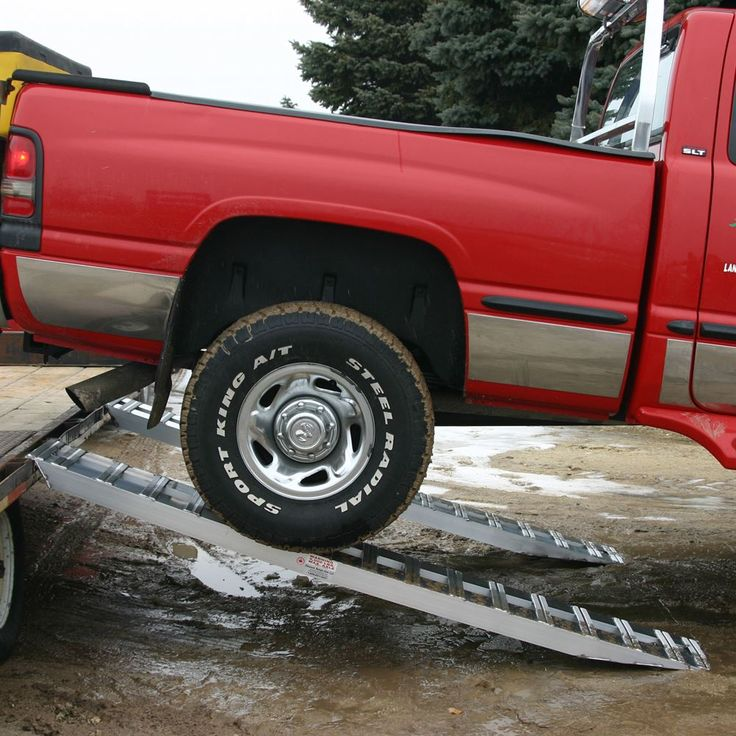Truck trailer ramps in use with pickup truck