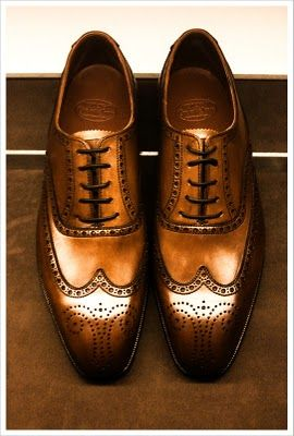 Cognac wing tip shoes