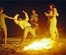 Beach bonfire party games: limbo, relay races, light up ball games or frisbee