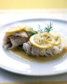 Lemon slices help keep the fish moist during cooking. For a simple sauce, we combined lemon juice, white wine, and butter.
