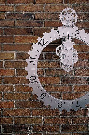 The mechanical gears of the clock give an even more industrial look to this condo against the titular red brick wall.�