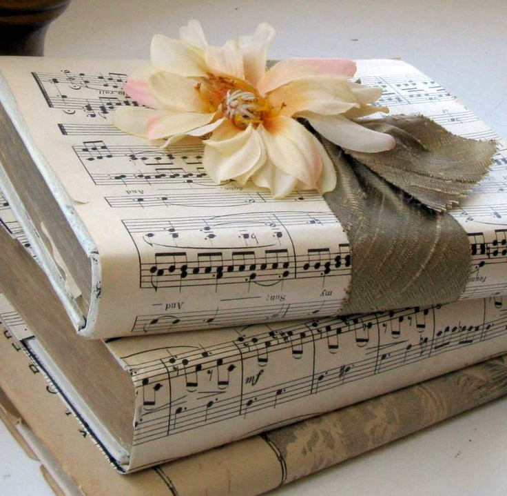 Stacks of sheet music-covered books tied together with gold ribbons! Or mix up with a gold paper-wrapped covered books