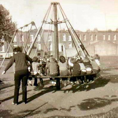 """THE WITCHES HAT"" ....Best thing we had on the Playground at our old Grade School.... Loved this thing...but Man was it DANGEROUS lol!!! (Especially when the mean ole' boys would push it and make us Whack into the middle lol) 