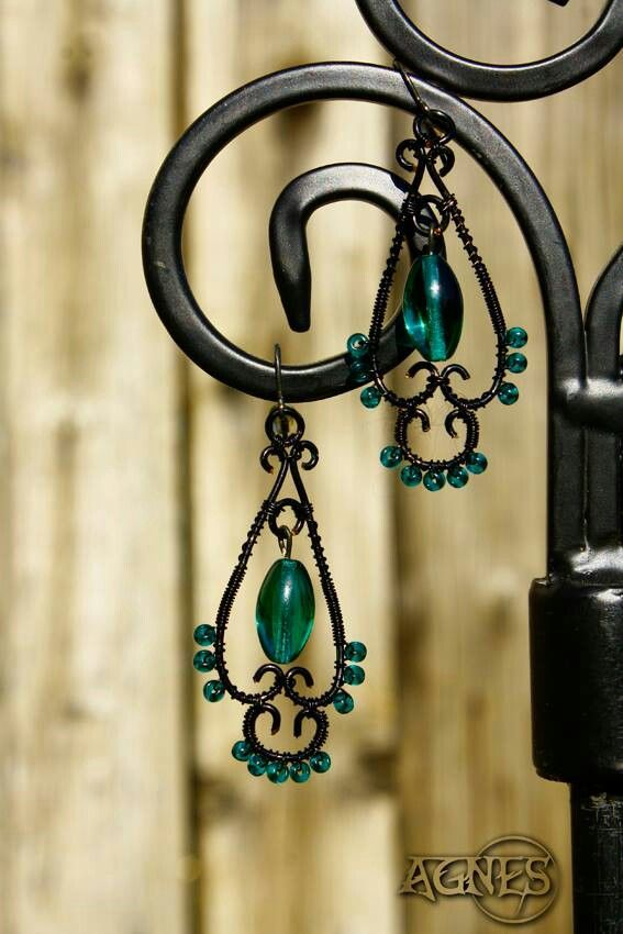 Earrings with tyrkys beads. Jewel made by wire wrapping. Hand made.