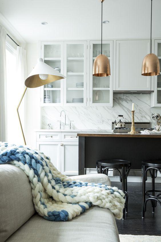 white hamptons kitchen with a dark island