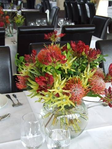 Centrepieces of red waratahs and green leucadendron