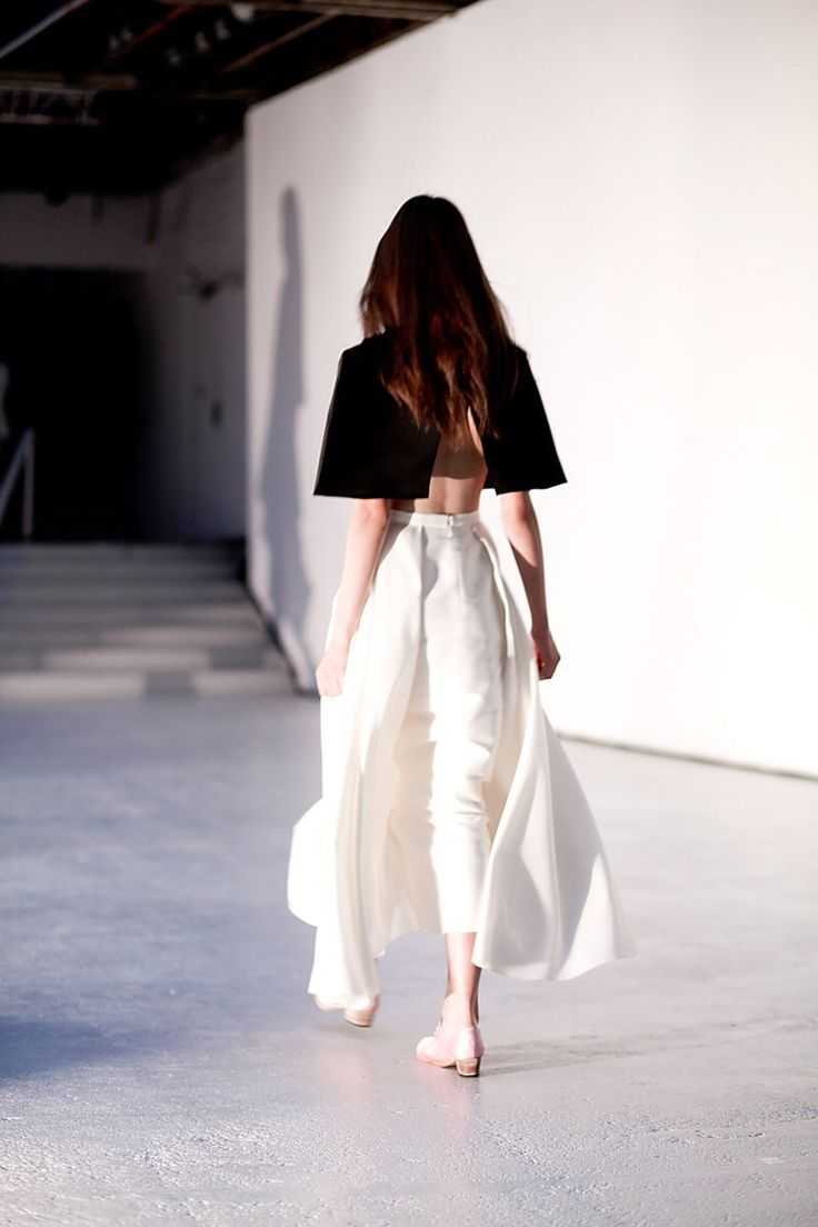 Black and white. Cape-like top and flowing skirt.