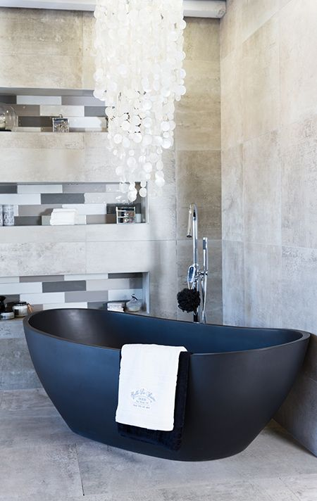 Many homeowners would like to incorporate concrete finishes in a home - without the mess, hassle and cost normally associated with these finishes. A new trend is to use concrete-look tiles.