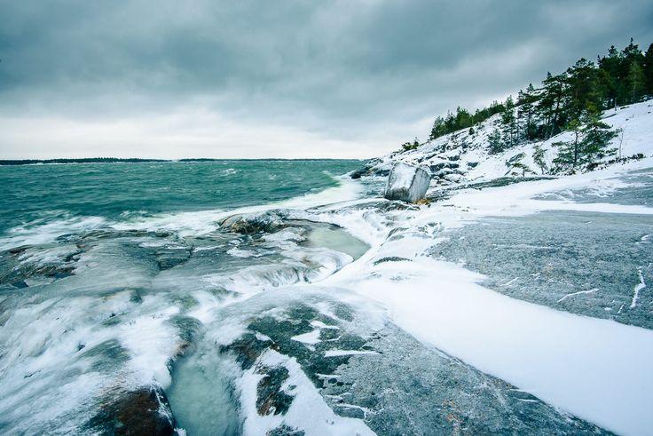 Waves crashing against frozen rocks in Porkkalanniemi peninsula in the Gulf of Finland