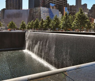 NATIONAL SEPTEMBER 11 MEMORIAL, New York City, opened in Sept 2011, the two illuminated reflecting pools - occupying footprint of Twin Towers - & 400 white oaks create a calming, respectful space to commemorate 9/11.