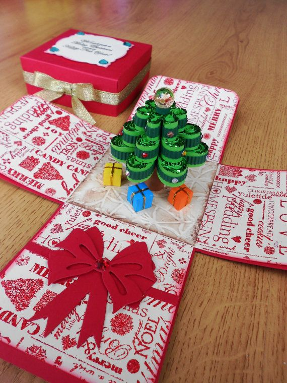 By LittleSofi on etsy. Incredible cards. The card pop when the lid is removed, revealing a paper quilled Christmas tree in the middle. To close the box, simply fold