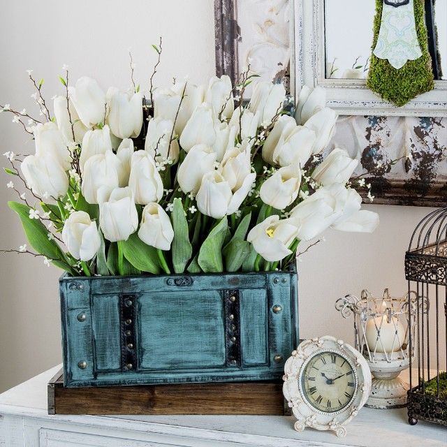 """Springtime on your mind? Usher in the new season with faux tulips and bright green mossy accents. #spring #diy"""