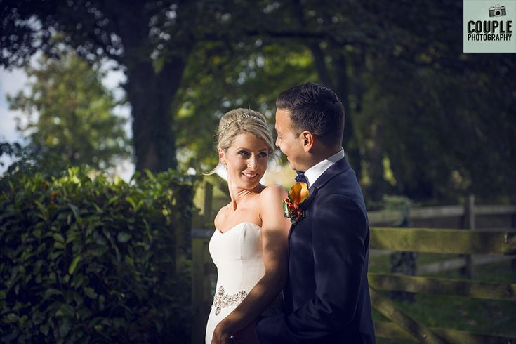The bride & groom take a moment in that beautiful autumn light. Weddings at Durrow Castle photographed by Couple Photography.