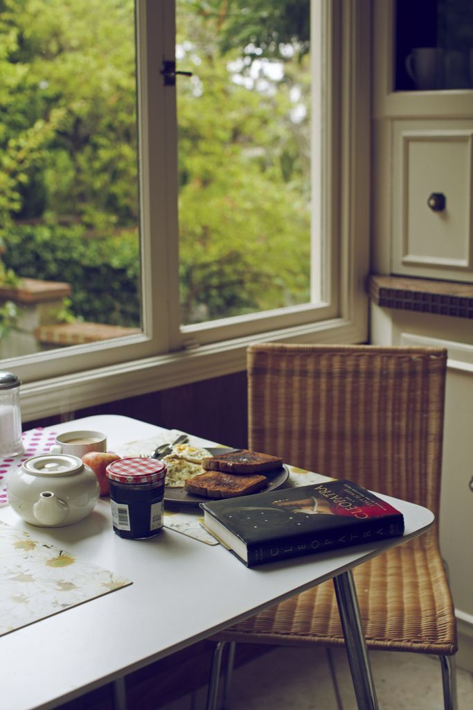 A good book. Slow morning. Breakfast taken as a meal. Peace. Green trees. Companionship that is perfect in silence, and the passing of the teapot.