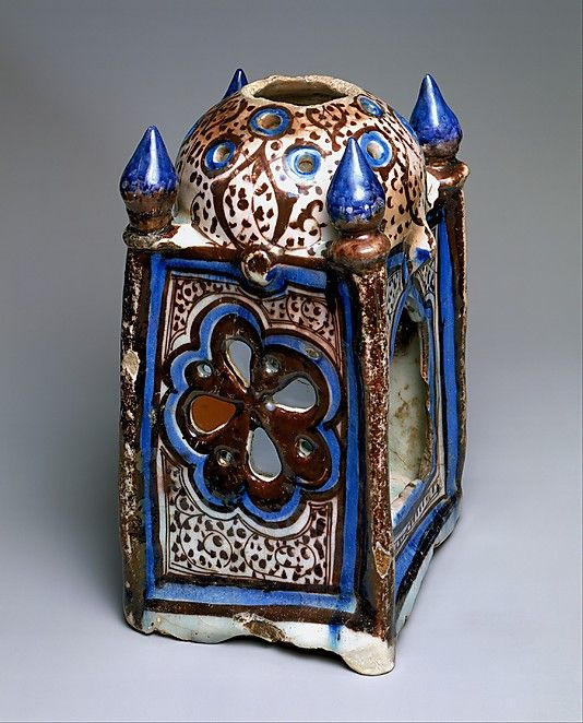 Object Name:     Lantern Date:     early 13th century Geography:     Syria, probably Raqqa Medium:     Stonepaste; underglaze painted in blue, luster-painted on transparent glaze