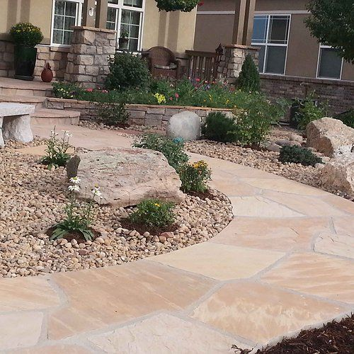 An inviting flagstone pathway leads you through a xeric Colorado garden to your front door. www.earthscaped.com