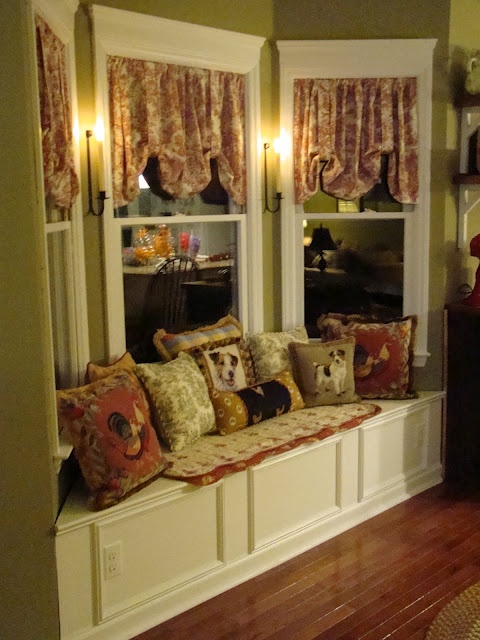 Bay window seat / storage.  Strongly Dislike the decor, but saving for the DIY idea and angled/bay window seat is same as what I have...need to build this!