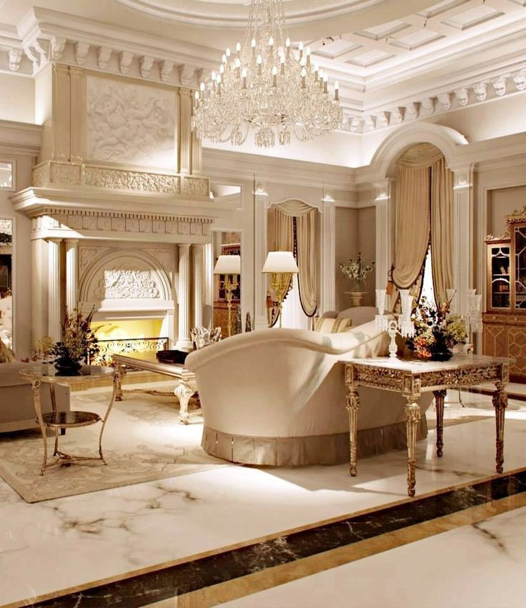 luxury homes interior designs with chandelier and fireplace with details walls and victorian furniture grandeur luxury homes interior designs interiors