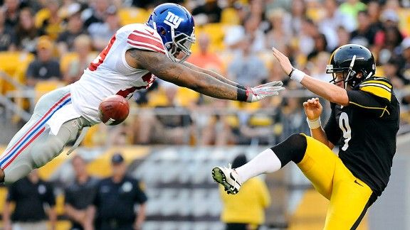 Damontre Moore shows his 'DaMonster' alter ego by bocking a punt leading to a score for the NY Giants. ESPN IMG
