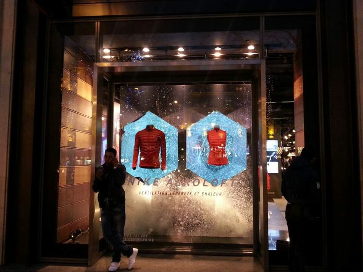 Nike retail store displaying 'Airoloft' with LED iced background and it caught my eyes at Champs-Élysées street in Paris.