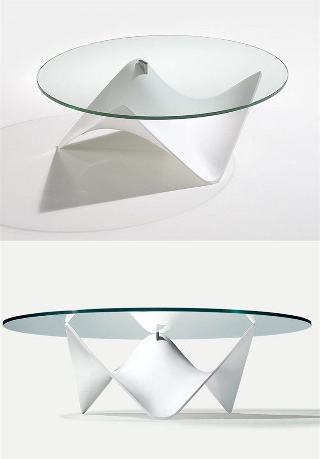 I love the base on this glass top coffee table -  STINGRAY by Draenert | designer Stephan Veit