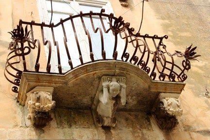Baroque balcony in Ragusa Ibla