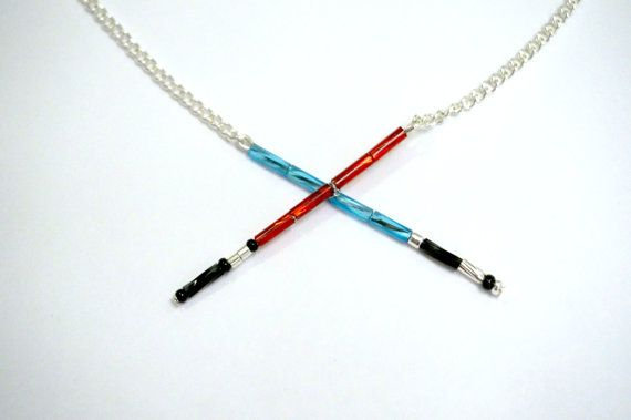 Dueling Lightsabers Necklace by ScienceAndFiction on Etsy