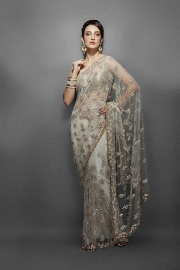 Ivory net sari with intricate gold