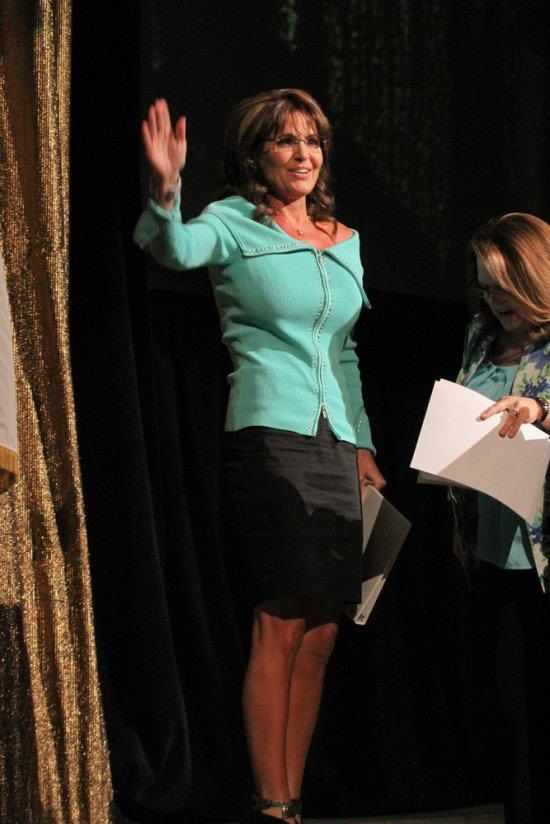 Full-Body Shot: Gov. Palin enters the stage to deliver her speech to Shareholders in Life fund-raiser and silent auction audience on April 26, 2013.