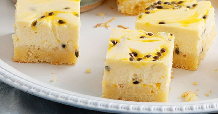 This slice has a coconut base and a tangy cheesecake topping swirled with real passionfruit pulp.