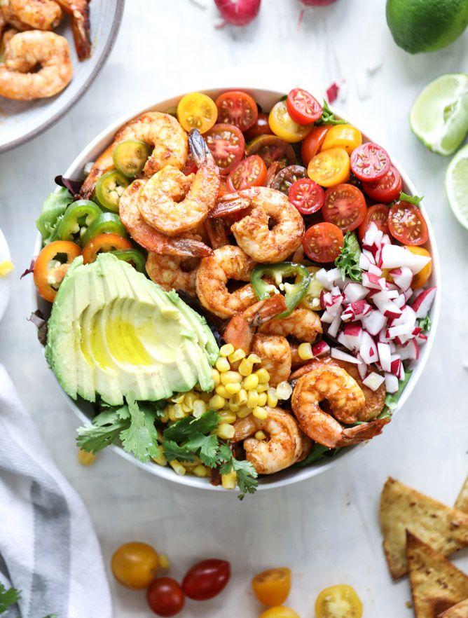 tequila shrimp taco salad with honey garlic vinaigrette (1 lb shrimp, 2 tbs tequila, garlic, lime juice and zest, chili powder, cumin, green onions, radishes, cherry tomatoes, jalapeno pepper, avocado, sweet corn, cilantro, queso fresco)