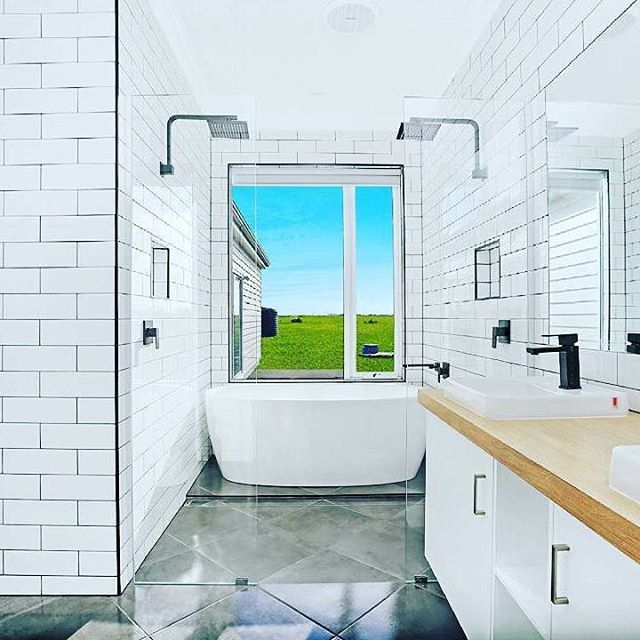 This absolutely stunning monochrome bathroom by @novarahomes has been extremely well designed and features only the highest quality finishes. These include a luxury freestanding bath which is tucked away behind the frameless shower, modern floor to ceiling subway tiles and our unique range of matte black tapware and showers which truly create an amazing contrast against the white tiles. meiraustralia#Meir #Meirblack #Meiraustralia #Blacktapware #Matteblacktapware #interiorlovers…