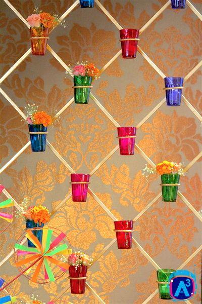 multicolour tumblers in decor, unique  decor ideas, tumbler wall, unique floral arrangement, floral wall